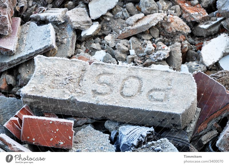 Frost on building rubble Construction site Building rubble stones Mail Winter ice crystals Frozen Cold Container
