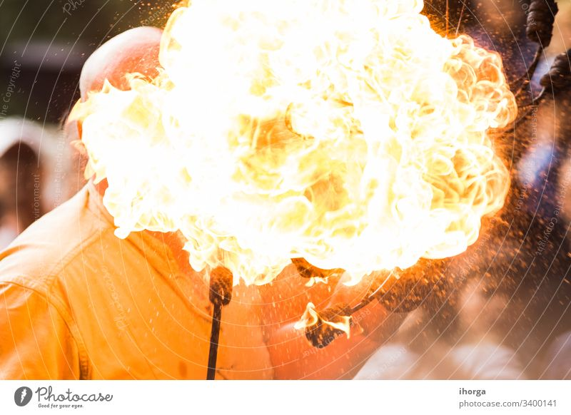 Fire show artist breathe fire in the dark jamp Danger Power actions activity arts background black burning business circus dramatic exhibition exploding fakir