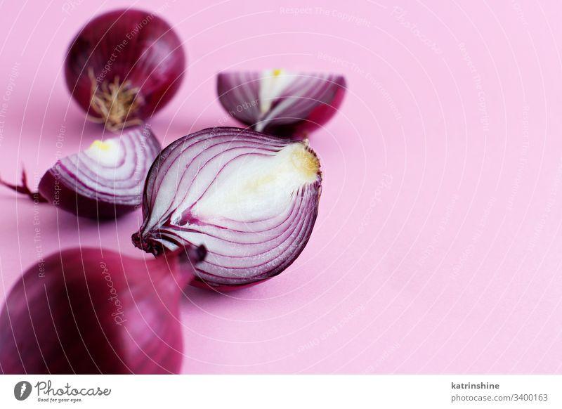 Purple onion on a light pink background purple red sliced half food healthy monochrome raw organic vegetable ingredient vegetarian ripe vitamin natural harvest