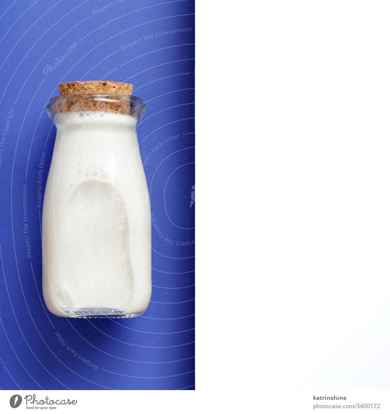 Milk on a white and blue background milk beverage jar minimal top view above classic blue bottle breakfast diet drink negative space copy space food fresh glass