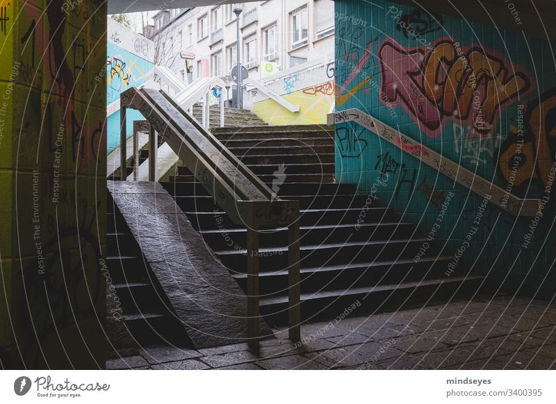 Staircase with graffiti Stairs Banister Dark Graffiti urban city views Underpass Town Darmstadt Arrow colors stagger dark & gloomy variegated Colour street art