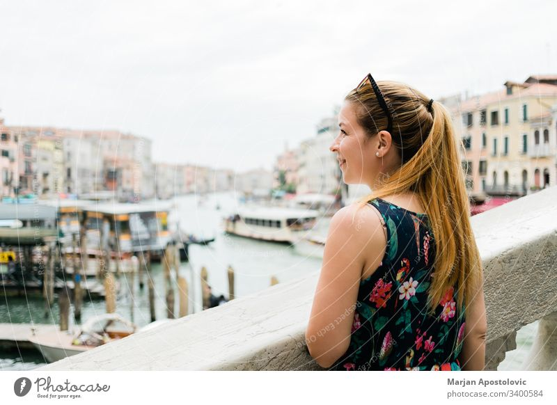 Young female traveler in Venice, Italy enjoying the view of the grand canal attraction beautiful blogger bridge caucasian chanal city cute day europe famous