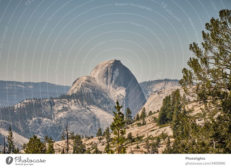 Yosemite National Park - Half Dome Impressive Elements Climate change Far-off places Sky Summer Rock Climbing Brown Gray Green Blue Sun Peak Hill