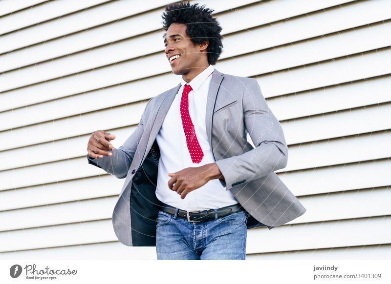 Happy Black Businessman wearing suit dancing outdoors. black businessman happy curly afro joy you hair african male adult portrait american person casual guy