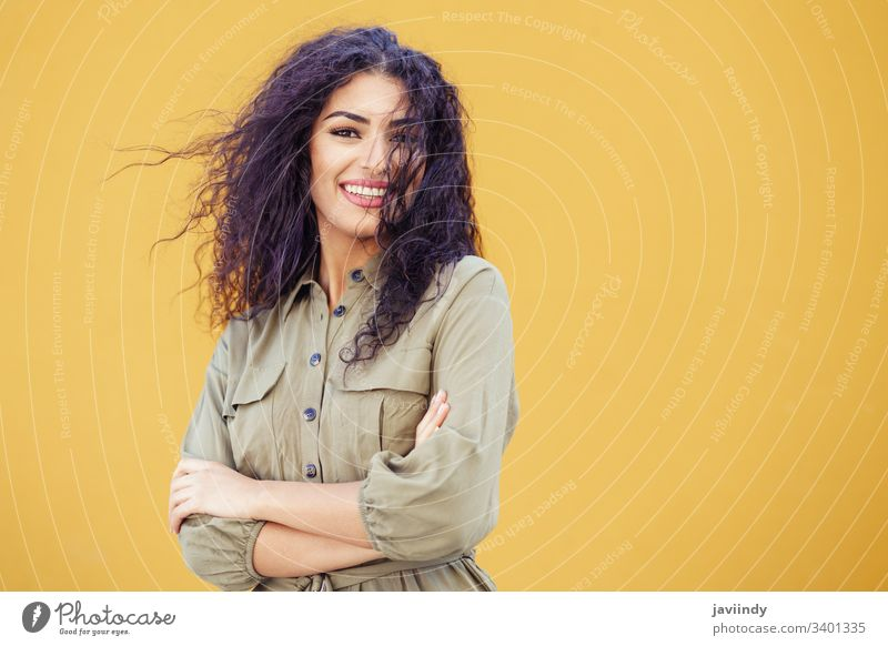 Young Arab woman with curly hair outdoors Woman Hair Curly hairstyle Smiling Beautiful Girl Beauty & Beauty youthful Fashion copyspace Middle East Yellow Green