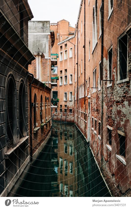 View of the rustic architecture of Venice, Italy canal alley alleyway ancient antique beautiful boat building city cityscape colorful destinations europe