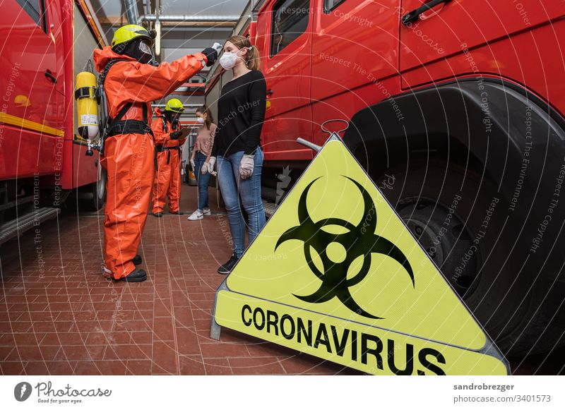 Firefighters in disease control suits examine people suspected of being infected with corona virus coronavirus covid-19 Virus Illness pandemic Epidemic Mask