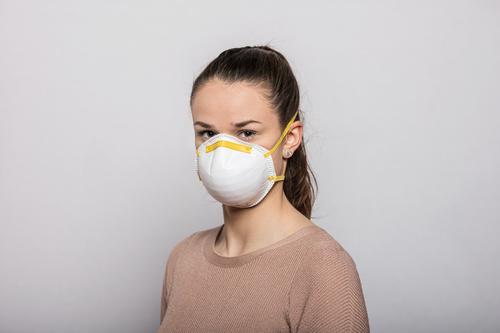 Girl with face mask coronavirus covid-19 Virus Illness pandemic Epidemic Mask guard sb./sth. disposable gloves hand protection Sterile Sick medicine Quarantine