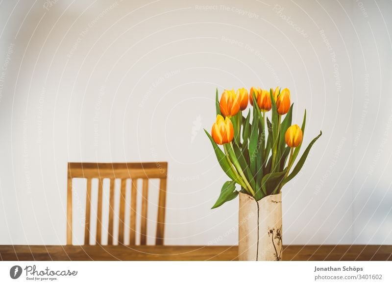 beautiful tulips in vase on the table as a gift for Mother's Day heyday flower decoration Tulip background Beautiful Beauty and beauty Blossom Bouquet Bright