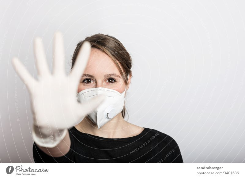 Woman with face mask and gloves stops the Corona Virus epidemic coronavirus covid-19 Illness pandemic Epidemic Mask guard sb./sth. disposable gloves