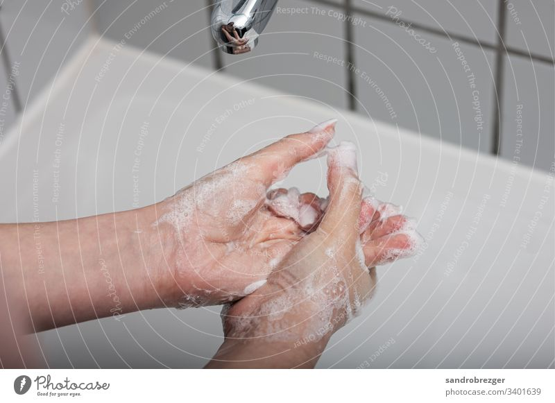 Woman washing her hands coronavirus covid-19 Virus Illness pandemic Epidemic Mask guard sb./sth. disposable gloves hand protection Sterile Sick medicine