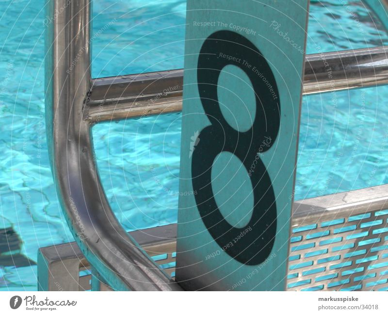 startblock no. 8 Swimming pool Open-air swimming pool Starting block (track and field) Reflection Digits and numbers Waves Sports Drops of water Water Sun Metal