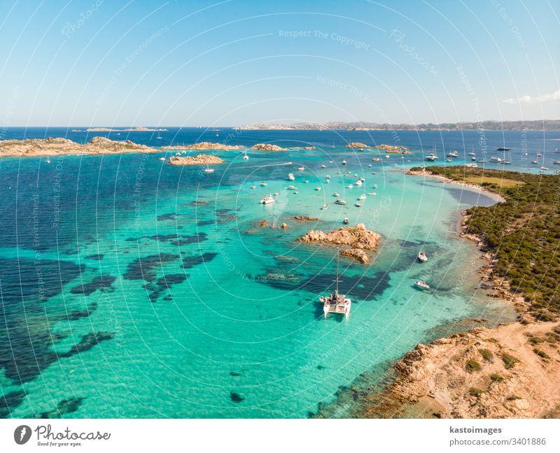 Drone aerial view of catamaran sailing boat in Maddalena Archipelago, Sardinia, Italy. italy sardinia costa smeralda sailboat bay beach nautics island coastline