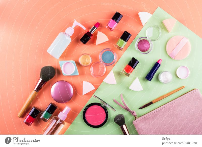 Make up accessories on cantaloupe orange and mint green paper background. Flat lay make up flat lay beauty products fashion color pink woman design geometry