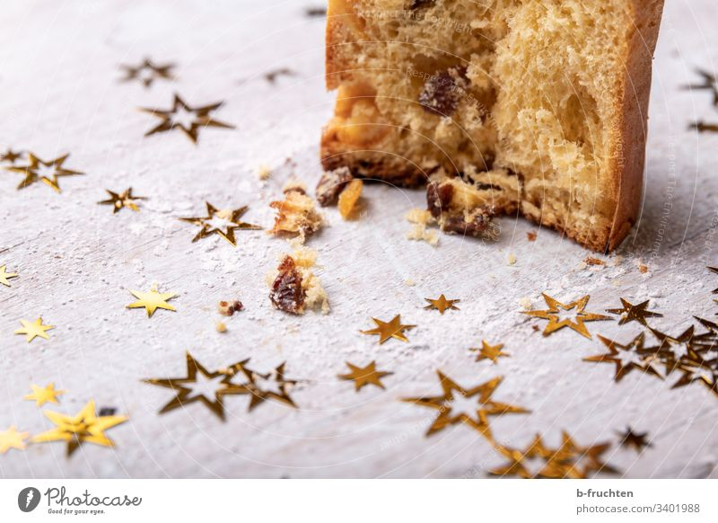A piece of panettone Panettone Cake Stars Christmas Baking slice Raisins Dessert Baked goods Sweet Delicious Tasty homemade Self-made Advent Christmas & Advent