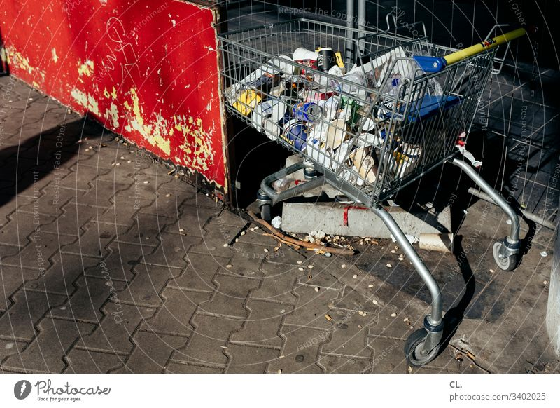 hamster purchase Shopping Trolley Supermarket Trash Trash container SHOPPING Shopping basket Consumption Colour photo Deserted Dirty Day Hoarding Exterior shot