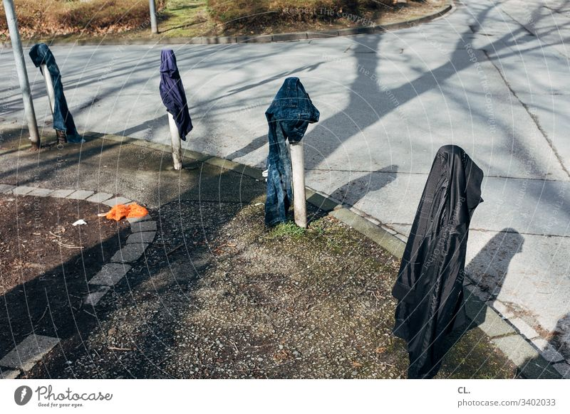 streetwear Street Curve garments Whimsical Lanes & trails Bollard Traffic infrastructure Exterior shot Transport Deserted Colour photo Day Pants Jacket Dirty