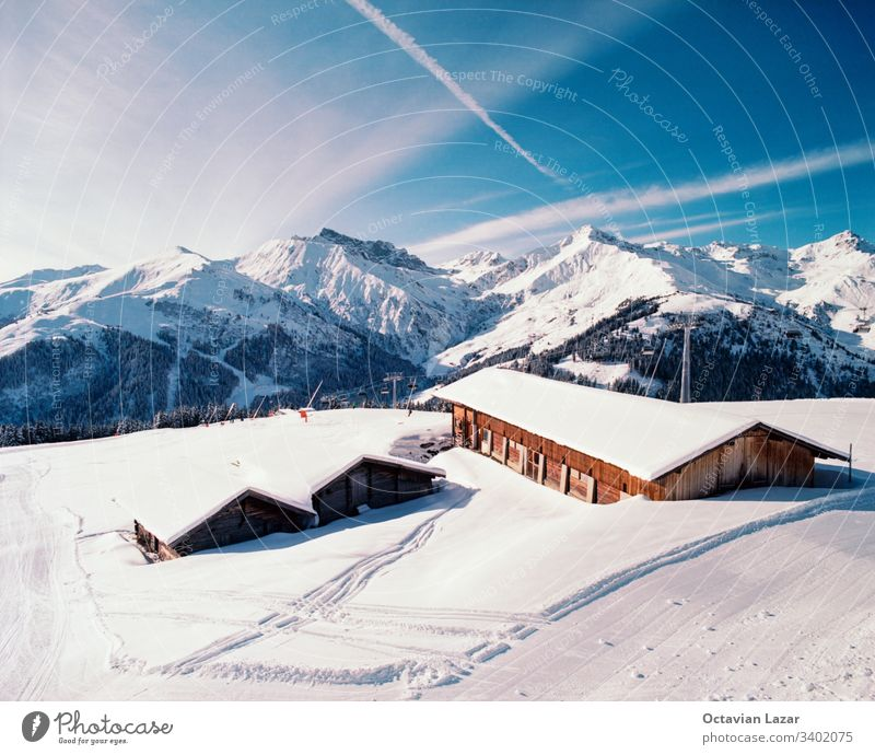 Winter mountain landscape in the Austrian Alps with wooden cabin in the foreground winter snow nature sky house rustic architecture outdoors tirol vacation