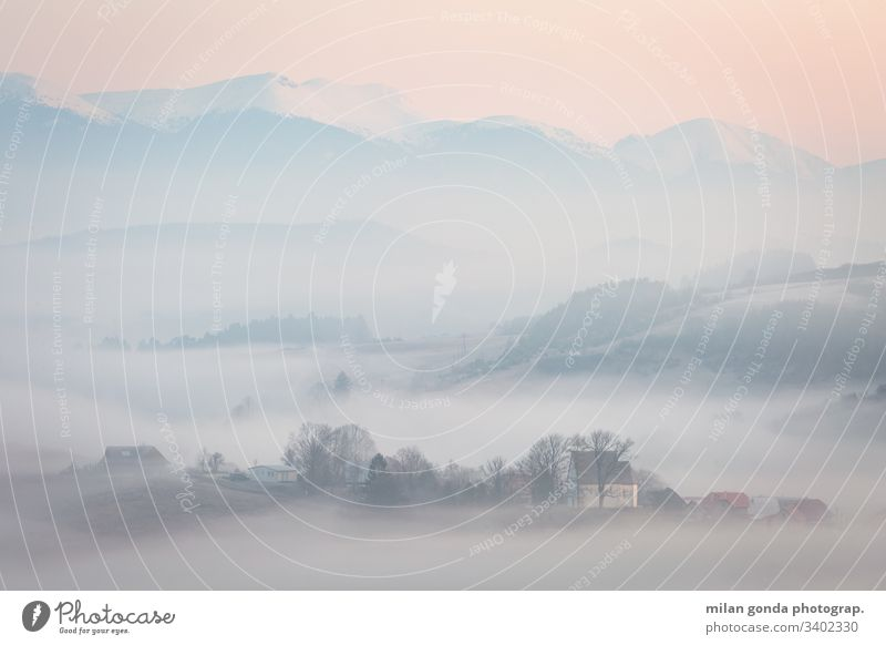 Foggy morning in Turiec region, Slovakia. landscape countryside rural village nature mountains Mala Fatra Carpathians church sunrise fog mist