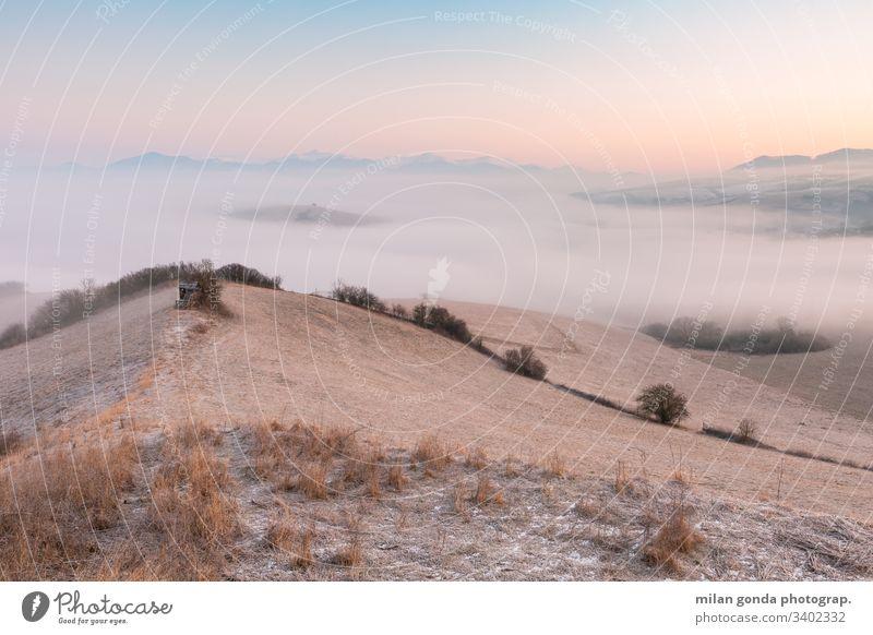 Foggy morning in Turiec region, Slovakia. landscape countryside rural nature mountains Mala Fatra Carpathians hunting lookout sunrise fog mist
