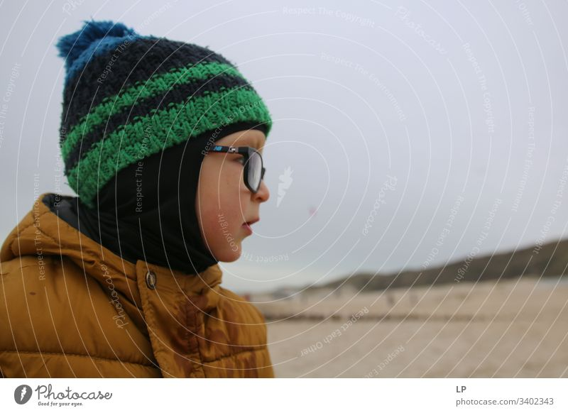 "profile of a child wearing  a hat and glasses Child childhood Looking Looking away Children's game Lifestyle leadership qualities Leader future,"" Horizon Future"