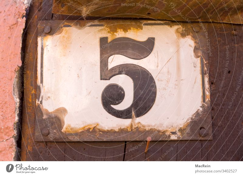 house number 5 House number Number plate digit five Enamel house wall Exterior shot Nail Rust nobody Copy Space