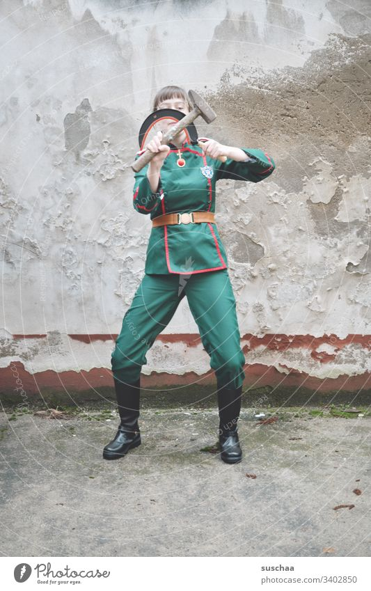 youth in uniform plays with sickle and hammer Youth (Young adults) teenager Young woman Uniform Soldier comedian comic fun Strange Funny Human being