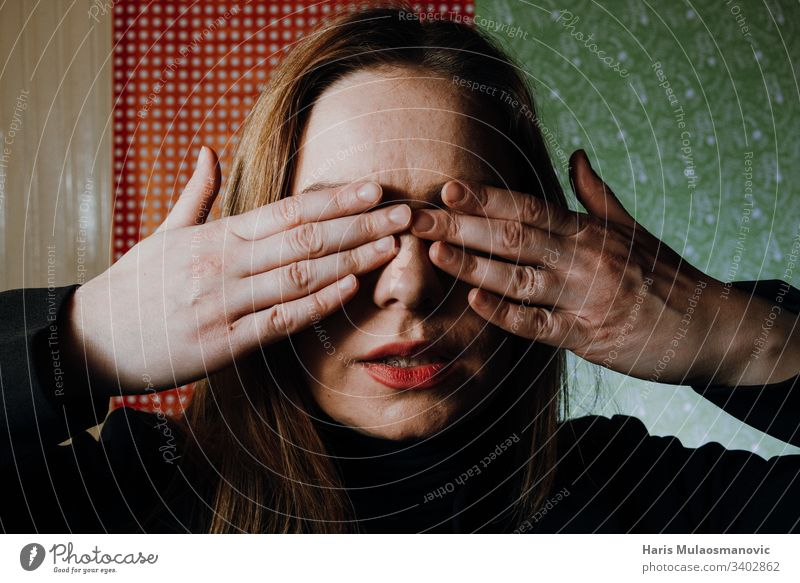 Woman abused face covered with hands abused woman abusing adult afraid background black casual caucasian concept dark emotion expression eyes fear female girl