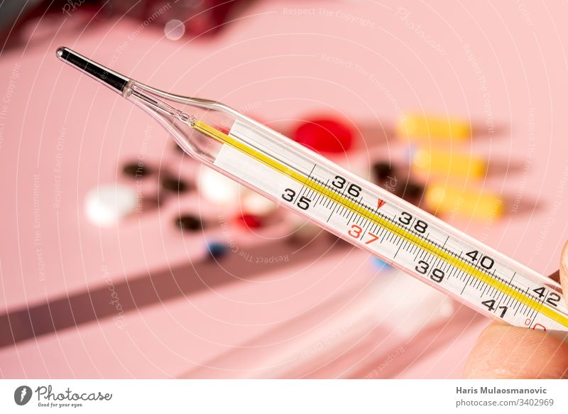 Medical thermometer 38 close up on colorful pink blurry background healthcare closeup cold corona corona europe corona virus disease doctor drug drug testing