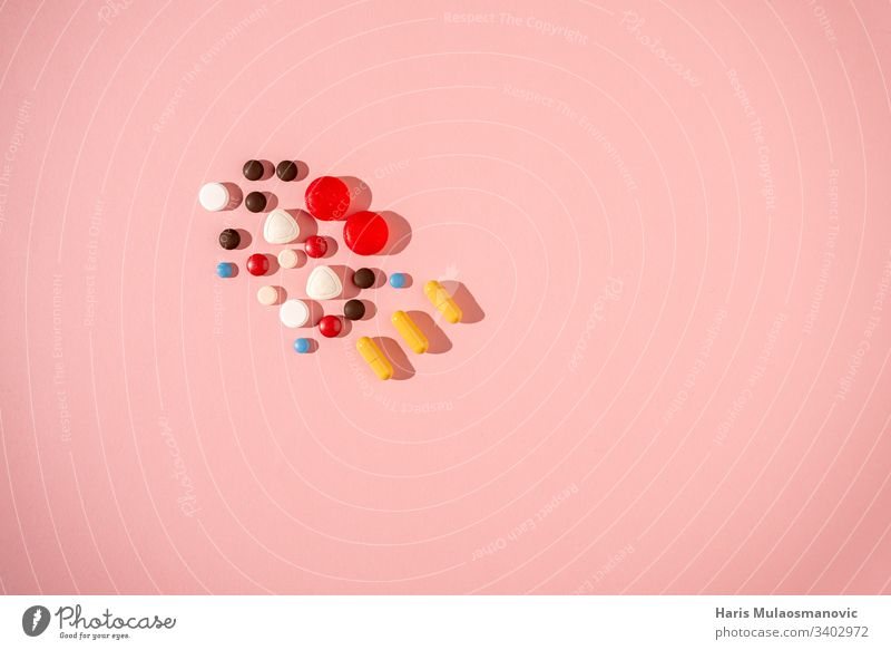 Colourful pill concept on pink background antibiotic Capsule care colourful Corona Design Medication Drug testing drugs Drug Concept Headache Healthy