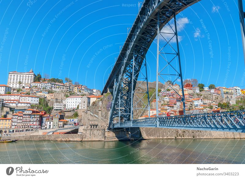 Dom Luis Bridge in Porto, Portugal porto portugal view old town douro city aerial europe river cityscape historic portuguese oporto travel tourism colorful