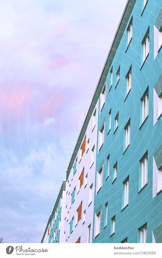 Facade prefabricated building against evening sky sunset Prefab construction Colouring of the prefabricated building Sky Sky blue High-rise Clouds Window Town