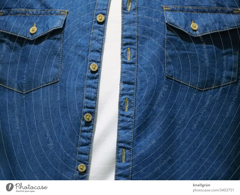 Men's chest dressed with white T-shirt and open denim shirt Clothing Upper body Fashion button facing Buttons Flap pockets Stitching Colour photo Style Textiles
