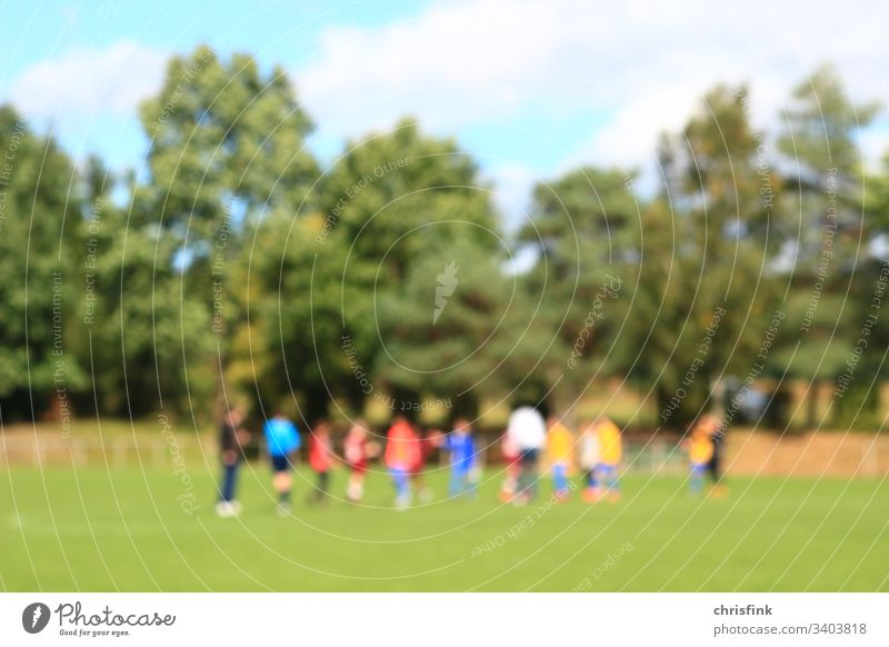 Football teams on grass pitch in break Foot ball speed Sports Blur Team gain Lose Coach coach youthful children boys Playing tournament Success Sun Summer