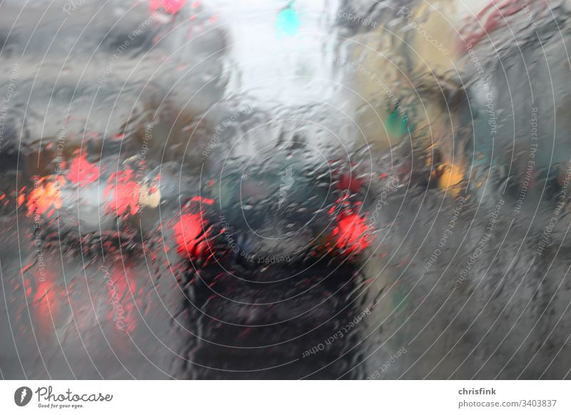 Car rear lights in front of rain-wet windscreen car Rain danger of getting wet Transport Drops of water Water Weather Exterior shot Bad weather brake