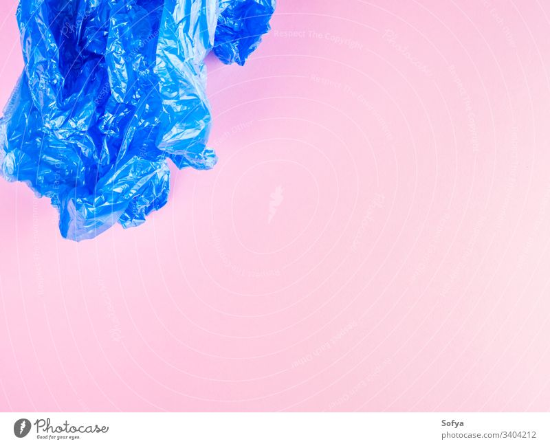 Crumpled blue plastic trash bag on pink background plastic bag plastic free recycling garbage flat lay pollution crumpled stop bags zero waste recycle