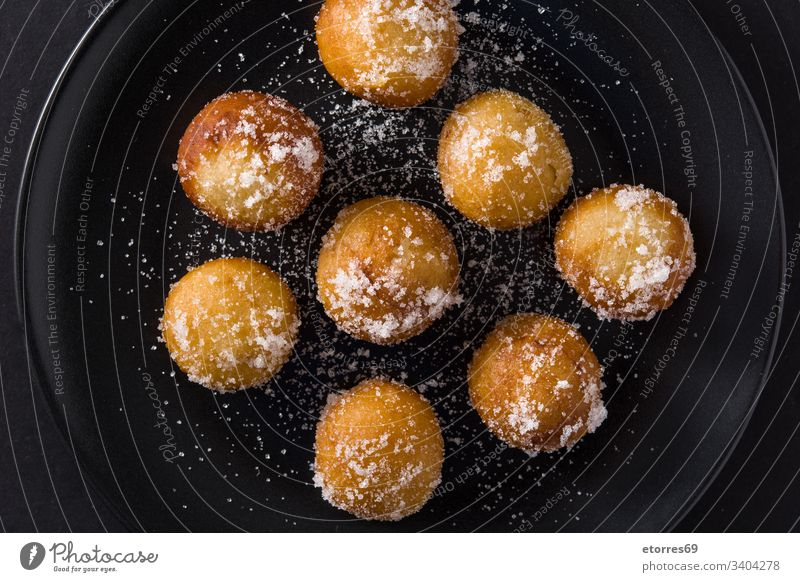 Carnival fritters or buñuelos de viento for holy week on black background top view artisan balls breakfast buns carnival christmas cooking dessert dough flour