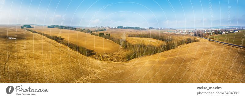 Panorama of empty plowed field in early spring. Beginning of the gardening season, aerial view agriculture cultivated scene rural industrial sunny outdoor
