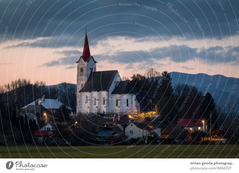 Church in Turciansky Dur village of Turiec region, Slovakia. landscape countryside rural architecture church historical heritage evening sunset mountains