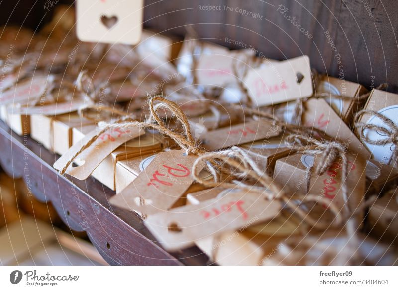 Gifts at a wedding with names on them gifts boxes cardboard brown wood surprise wishes occasion distribution distribute bow dates happiness decorative pack
