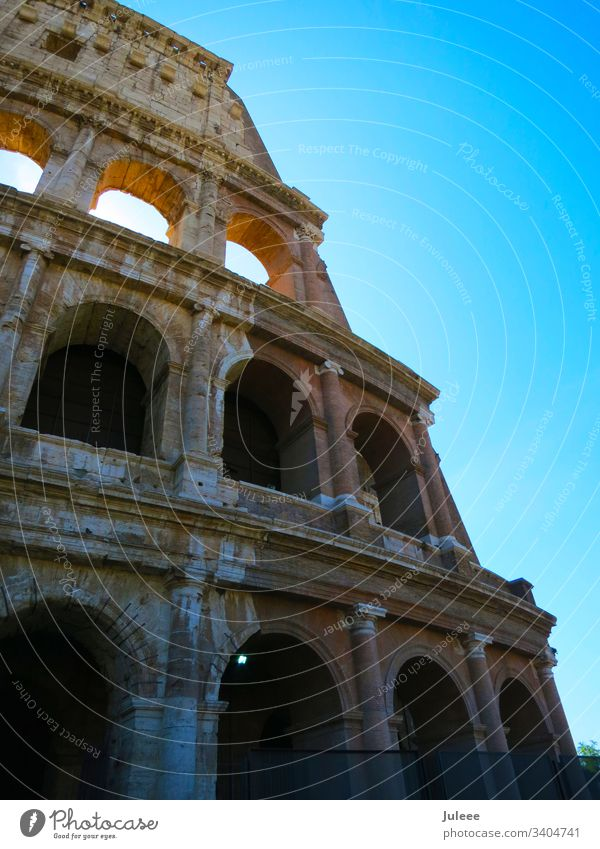 Colosseum travel touristic Tourism Summer Stone Stadium Sky Sightseeing Ruin Rome Roman Romany Old Monument Mediterranean Landmark Italy Italian Imperial