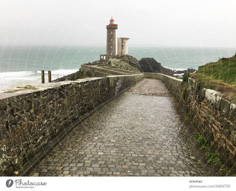 Lighthouse in the Bretagne Europe Tourism Tourist Attraction Architecture voyage Landscape Nature Paving stone Coast ocean off Lake Water