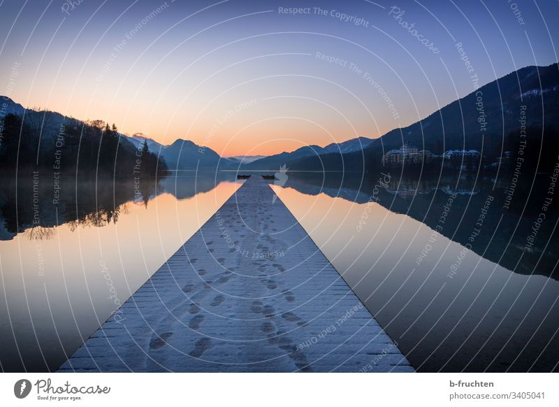 Dawn at the lake Lake tranquillity Footbridge wooden walkway Meditation reflection Fuschlsee Salzkammergut Sunrise Tracks Winter Snow Loneliness Landscape