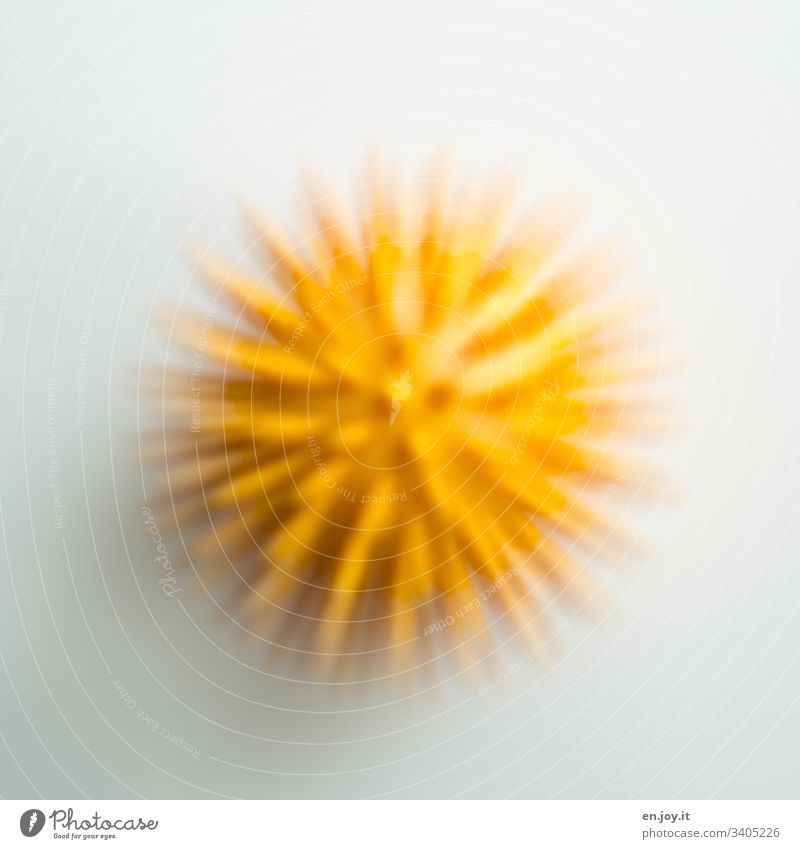 Yellow ball with spikes Ball Hedgehog ball Round Blur Motion blur Virus corona coronavirus Sports Healthy Illness Therapy Physiotherapy prickles