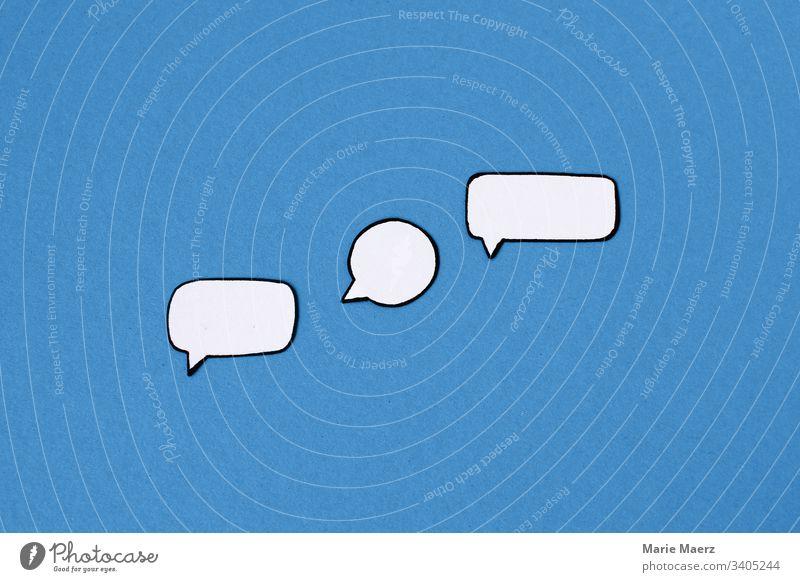 Three empty paper speech bubbles on a blue background Speech bubbles communication talk Chat Communicate Comic chat message Technology Internet Online