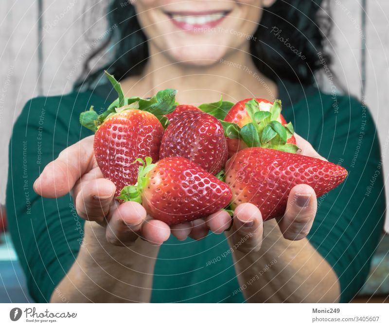 Human hands offering strawberries Strawberries spring tasty supplements food holding diet dessert fingers vitamin nutritionist tropical tangerine natural