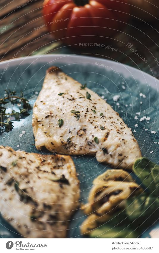 Fried fish with herbs and vegetables dish basil fillet plate shabby wooden fresh food tasty meal tomato onion fry roast seasoning piece cuisine ingredient