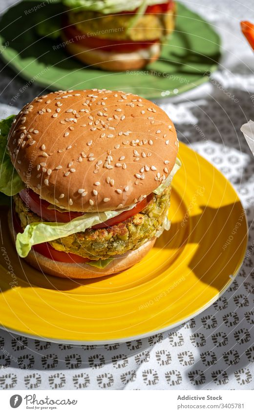 Homemade vegan green lentil burger burger healthy food vertical fast food vegan food natural homemade tomato lettuce lunch meal tasty chips copy space gourmet
