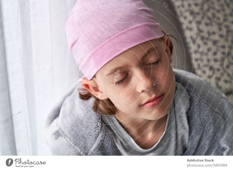 Adorable sick little boy in bandana in room cancer fight child small patient courageous disease male against awareness recovery strength kid willpower hope