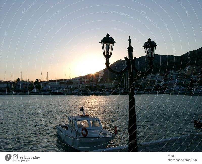 Sunset at the harbour Greece Samos Ocean Dusk Romance Lantern Watercraft Calm Europe Harbour Evening